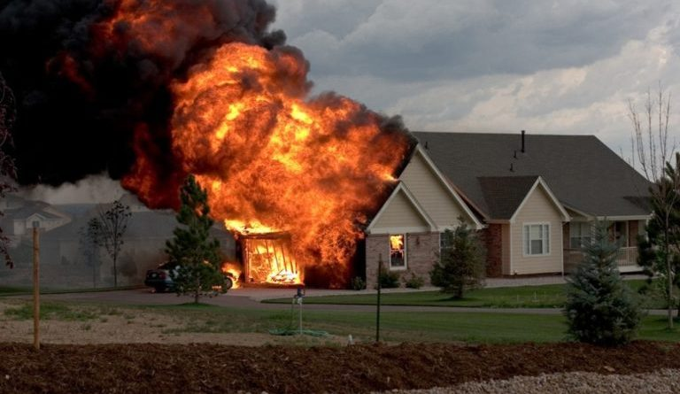What does it mean to dream about a fire burning your house?