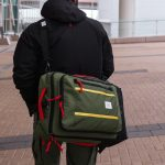 What does it mean to dream about helping someone carry a bag?